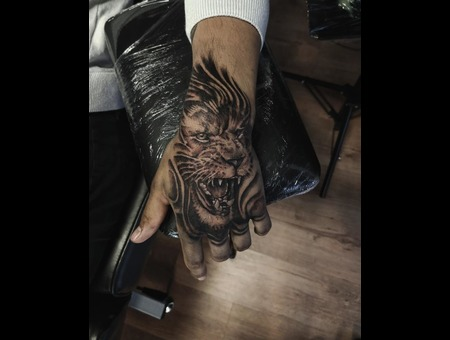 Lion  Hand Tattoo Design. #Inkandarttattoo Ink & Art Tattoo Shop Black Grey Arm