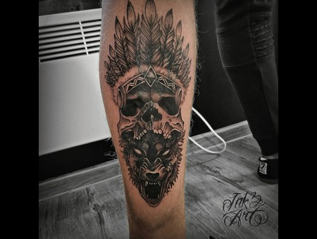 Native Indian Skull On Top Of Wolf. Ink & Art Tattoo Shop Black Grey Lower Leg