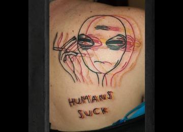 Weird trippy tattoos