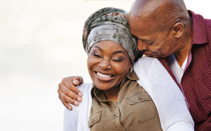 Life insurance and cancer older couple embracing each other