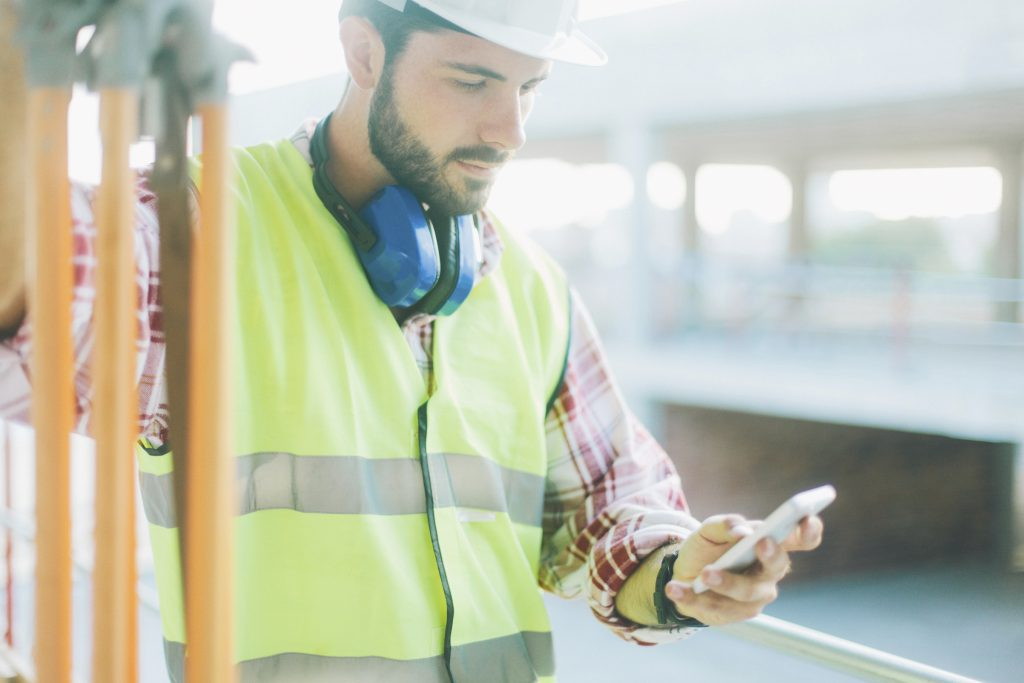 Land surveyor on phone using app
