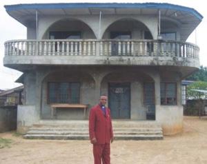 Amos Kalu before Unity Church Nigeria building
