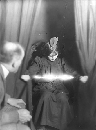 Medium Eva Carrière photographed in 1912, with an apparent light appearing between her hands - Wikipedia