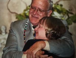 Max Lafser hugging a congregant