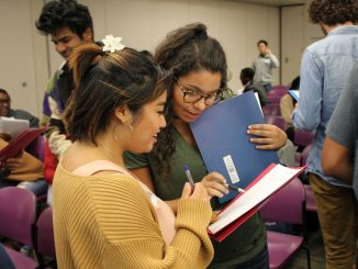 Peer mentors Natalie Abellanosa (left) and Julia Ostrovsky participate in a scavenger hunt at a peer mentorship event in September. | CHYNNA CUMMINGS /FILE PHOTO