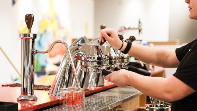 Julia Maass, a senior tourism and hospitality management major, handles an espresso machine in Speakman Hall's student-run Saxbys, which is scheduled to open Wednesday.   SYDNEY SCHAEFER / THE TEMPLE NEWS