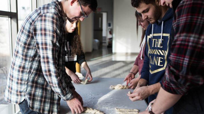 Members of Temple's Challah for Hunger chapter braid challah dough in the Hillel at Temple University on Norris Street near 15th on Thursday. | SYDNEY SCHAEFER / THE TEMPLE NEWS