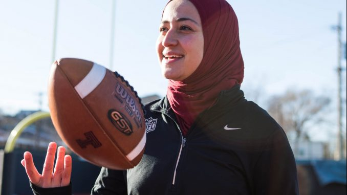 Ameena Soliman, a 2017 finance and marketing alumna, poses at Chodoff Field at 10th and Diamond streets on Sunday. She spent the 2017 season as a graduate assistant in operations and recruiting at Temple and now works at the NFL office in New York City.   SYDNEY SCHAEFER / THE TEMPLE NEWS