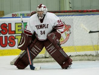 Will Neifeld stands in goal on Feb. 7 at the Northeast SkateZone. Neifeld left the ice hockey team at the end of last year for personal reasons. ( PAUL KLEIN / TTN FILE PHOTO )