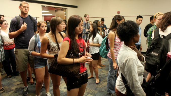 The second floor of the Student Center was lined with students yesterday, Aug. 27, as they waited to get their new Owl Cards. Old cards will remain valid until Sept. 10, when Temple will start using the newly issued IDs. ( KATE MCCANN / TTN )