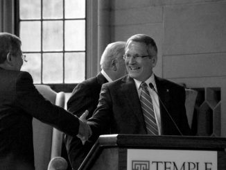 Dr. Neil Theobald is congratulated by Acting President Englert as he was approved as Temple's next president at a Board of Trustees meeting in August. Theobald will assume the presidency Jan. 1. ( ABI REIMOLD / TTN )