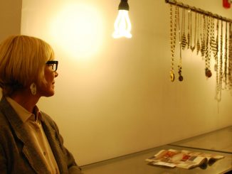 A jewelry designer looks at her collection in Knit Wit Boutique during Fashion's Night Out on Sept. 6. ( MARISSA PINA / TTN )