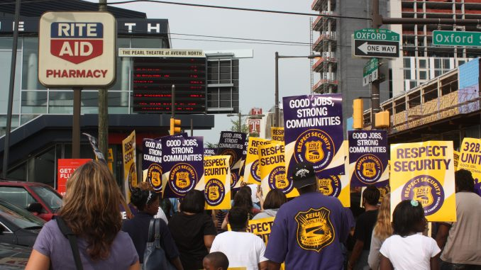 Students, security workers, and local residents march up North Broad Street in Thursday's rally. (John Moritz, TTN)