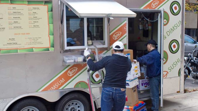 Busz Sushi & Dim Sum receives an order of supplies. The newly opened lunch truck is located on the 1300 block of Norris Street. | LUIS FERNANDO RODRIGUEZ / TTN