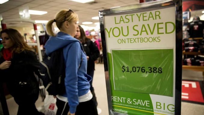 A sign boasts that students saved more than $1 million by renting textbooks last year. Temple's bookstore has the highest rate of textbook rentals. | HUA ZONG / TTN