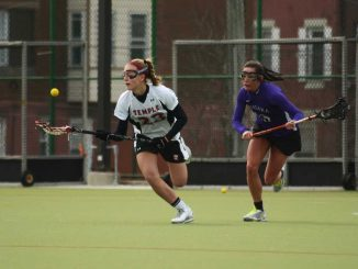 Freshman midfielder Bridget Hufnagel controls a ball against Niagara. Freshmen combined to score five of the Owls' 18 goals as they took the season opener 18-5. | MAGGIE TRAPANI / TTN