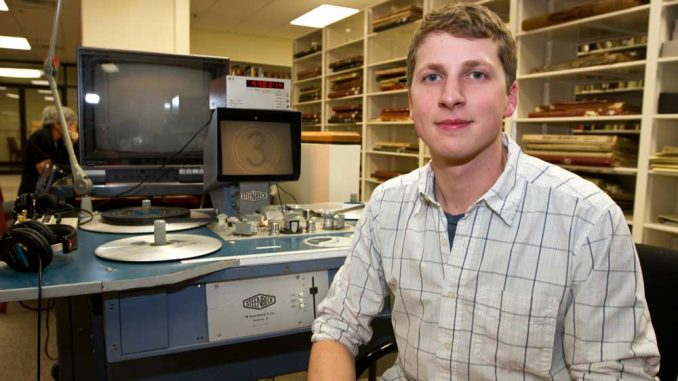 Jon Kohl, a film and media arts and history double major, has worked at Paley's Urban Archives since January 2011. The student uses his knowledge of archival footage in his position as an assistant producer and researcher of a Philadelphia documentary. Jon Kohl operates the reels in Urban Archives. Kohl's job includes sifting through boxes of film containing footage that no one has seen in decades. He once discovered footage from a Beatles concert in Philadelphia. | Steve Reitz / TTN