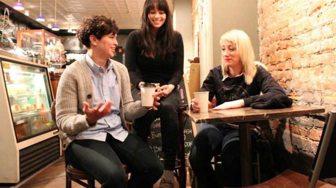(Left to right) Bassist Allegra Anka, drummer Kelly Olsen and singer-guitarist Augusta Koch sit in Milk & Honey Café on South Fourth Street. Cayetana self-released a demo in December 2012, which has been well-received by the DIY scene. | CARA STEFCHAK / TTN