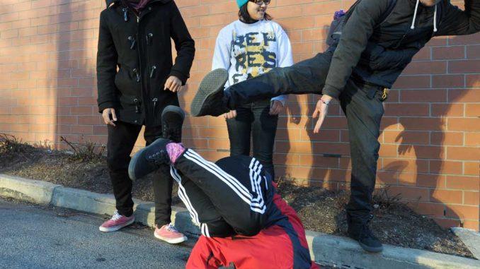 Danzel Thompson-Stout, Bea Martin and Cristian Barreto watch Neha Sharma breakdance outside the TECH Center. | ABI REIMOLD / TTN