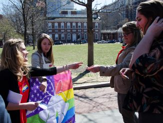Members of Philly Supports Liberty hand out LGBT rights stickers.   LAURA ORDONEZ / TTN