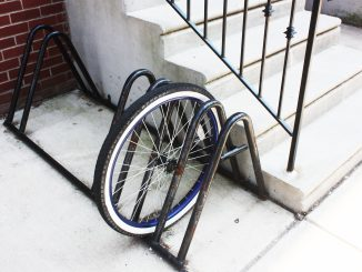 A wheel is all that is left of a bike chained to a rack on the 1500 block of North 15th Street.   John Moritz TTN