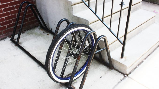 A wheel is all that is left of a bike chained to a rack on the 1500 block of North 15th Street. | John Moritz TTN