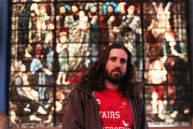 Matt Miceli, First Unitarian Church's building superintendent, sees the juxtaposition of charitable events by day, and punk DIY shows by night. | Kara Milstein TTN