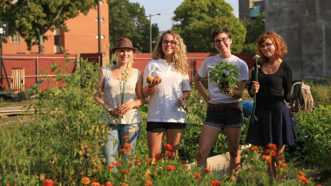 TCG members (from left) Mattie Hagermann, Sarah Andrews, Katy Ament and Joy Waldinger are the next generation of leaders at the community garden on North Broad Street. The garden allows members to grow their own food. | Hua Zong TTN