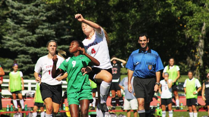 Senior midfielder Amanda Ward (right) and her team lost in the home opener to Marshall 1-0. The Owls began the season with four straight shutouts, a program record. | Aja Espinosa TTN