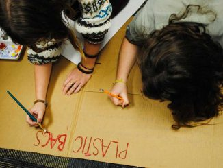 Vice president of SEA Morgan Nemtuda (left) and Bonnie DuPrey work on a poster that will display the negative effects plastic bags have on the environment as part of their new campaign to ban them on campus. Online. | Danielle Hagerty TTN