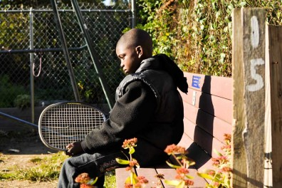 Kevon Lewis sits on a bench in an empty lot-turned garden on West Rockland Street in Germantown. The street is the subject of a community improvement project organized by sisters and street residents Emaleigh and Aine Doley.   JACON COLON TTN