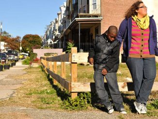 Emaleigh Doley (right) and Kevon Lewis stand in front of an empty lot on West Rockland Street that she and her sister Ainé helped improve in 2008. | JACOB COLON TTN