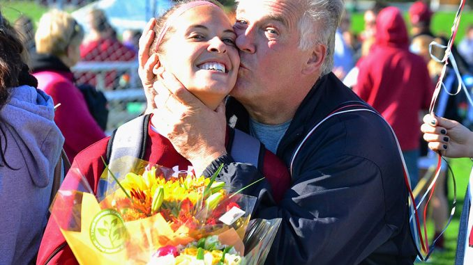 Jackie Krostek's father, Richard, gives his daughter a kiss after Sunday's game against Cincinnati.   Sergei Blair TTN