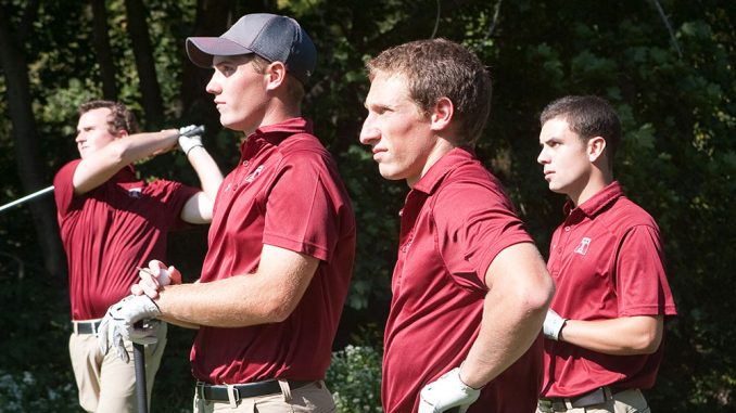 Freshman Evan Galbreath (second from right) looks onto the golf course at a recent practice. | Paul Klein TTN