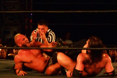 Adam Cole locks Tommaso Ciampo in the figure four as the referee looks on.   John Corrigan TTN