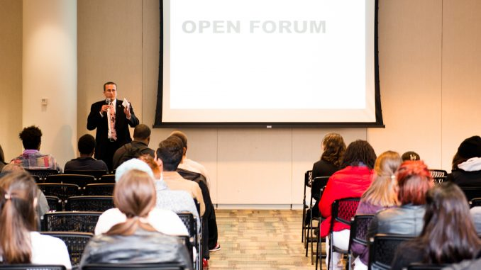 Darin Bartholomew speaks to an audience at the Temple Student Government general assembly meeting on Monday, Nov. 1. TSG announced talks with the university to address safety concerns. | Eric Dao TTN