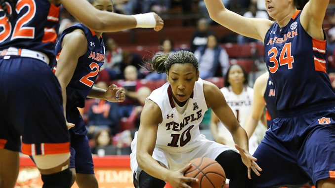 Fifth-year senior Shi-Heria Shipp dribbles through Auburn defenders during Temple's home opening victory on Saturday. Shipp is in her first season with the Owls after transferring from George Washington. | Hua Zong TTN
