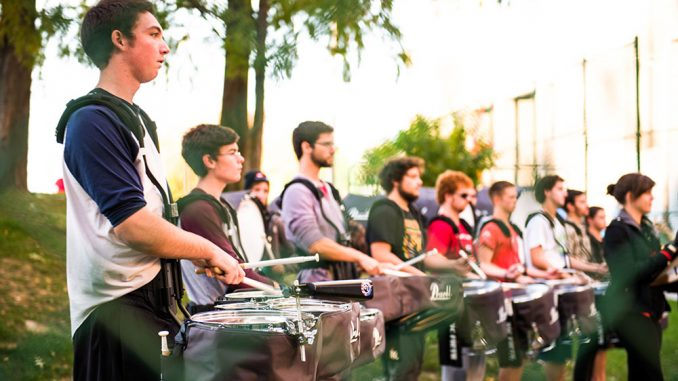 """Members of the Diamond Marching Band appear in atrailer for the upcoming Martin Scorsese film, """"The Wolf of Wall Street."""" The student musicians said costuming, rehearsing and filming took several days. 