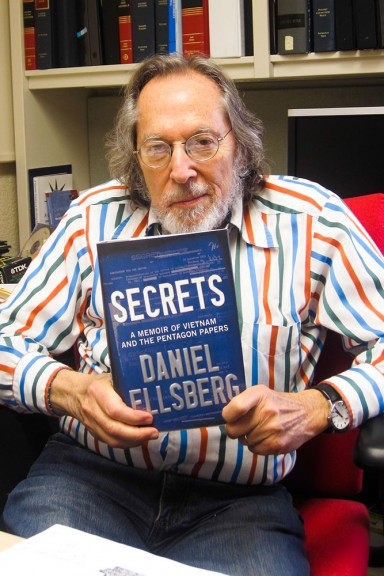 """Caine holds """"Secrets"""" by Daniel Ellsberg, what he calls a significant text to free speech. 