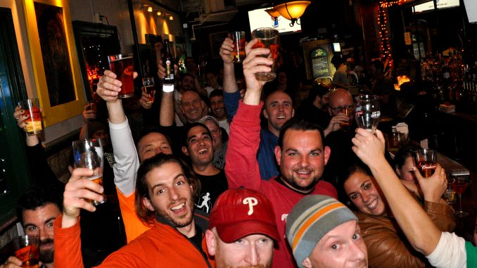 Members of the Fishtown Beer Runners celebrated a successful five-kilometer run at Kelliann's Bar & Grill on 16th and Spring Garden Streets on Nov. 14. | Jacob Colon TTN