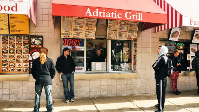 Adzij Kovevic, the owner of Adriatic Grill at the 12th Street Food Pad, said he intends to making at least one special dish for the upcoming holiday season.   Jacob Colon TTN