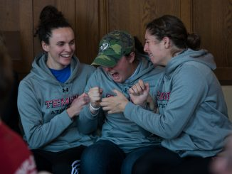 (From left) Rowers Layla Moran, Rachael Braccia and Kelly Hill react in excitement to the news that the men's crew and women's rowing teams will be reinstated. The programs were slated to be eliminated this summer before the Board of Trustees reversed its decision. | ABI REIMOLD TTN