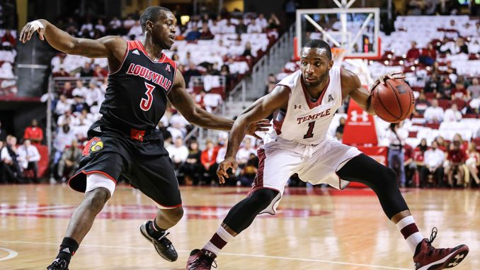 Freshman guard Josh Brown dribbles while facing Louisville's Chris Jones. The Owls lost to the Cardinals 82-58, but defeated Southern Methodist a few days later. | Hua Zong TTN
