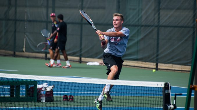 Sophomore Nicolas Paulus hits a ball while competing at the Navy Invitational last September. Paulus collected an 8-5 record during the fall season and led the team in single wins with 15 during the 2012-13 season. | Abi Reimold TTN
