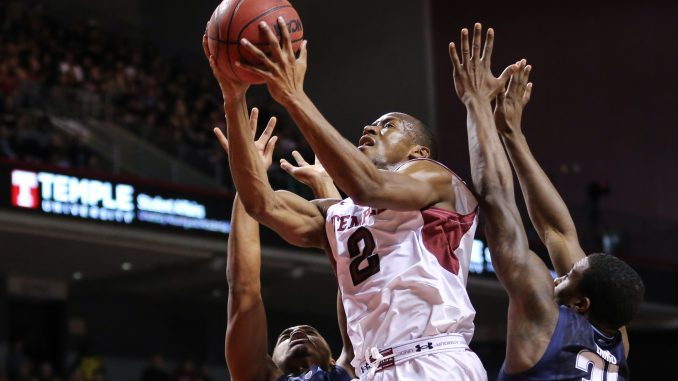 Guard Will Cummings drives to the basket against Villanova defenders. Cummings tallied a game-high 24 points in the Owl's 90-74 loss to the Wildcats last Saturday. | Hua Zong TTN