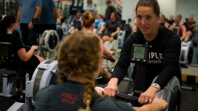 Second-year head coach Rebecca Grzybwoski talks to one of her rowers in McGonigle Hall. | Abi Reimold TTN