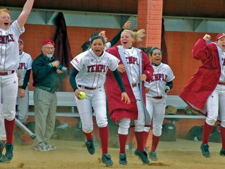 Members of the 2006 softball team celebrate during a spring game at the Ambler Sports Complex. The Board of Trustees voted to cut the team in December.   TTN FILE PHOTO