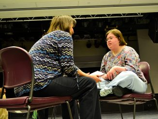 Erin McNulty (right) interacts with another cast member in a play produced by Visionary Voices.   Sergei Blair TTN