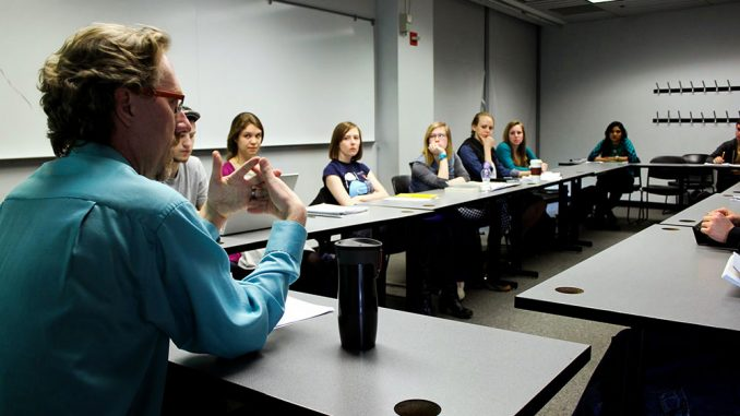 Andrew Karpinski (left) has taught Workings of the Mind for six years. He believes the subject matter of the class can cause some students to feel discomforted because they are asked to question the purpose of their own existence. He advises the use of on-campus counseling services.   Claire Sasko TTN