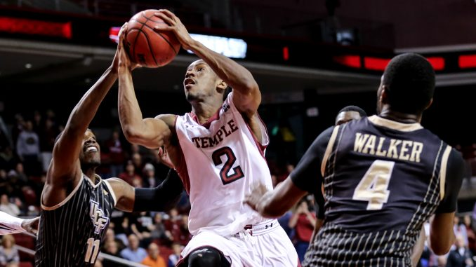 Junior guard Will Cummings (center) drives to the hoop during Temple's 86-78 overtime win against Central Florida, which improved Temple's home record to 4-9. The Owls will face the Knights again on Wednesday in the first round of the American Athletic Conference tournament. | HUA ZONG TTN